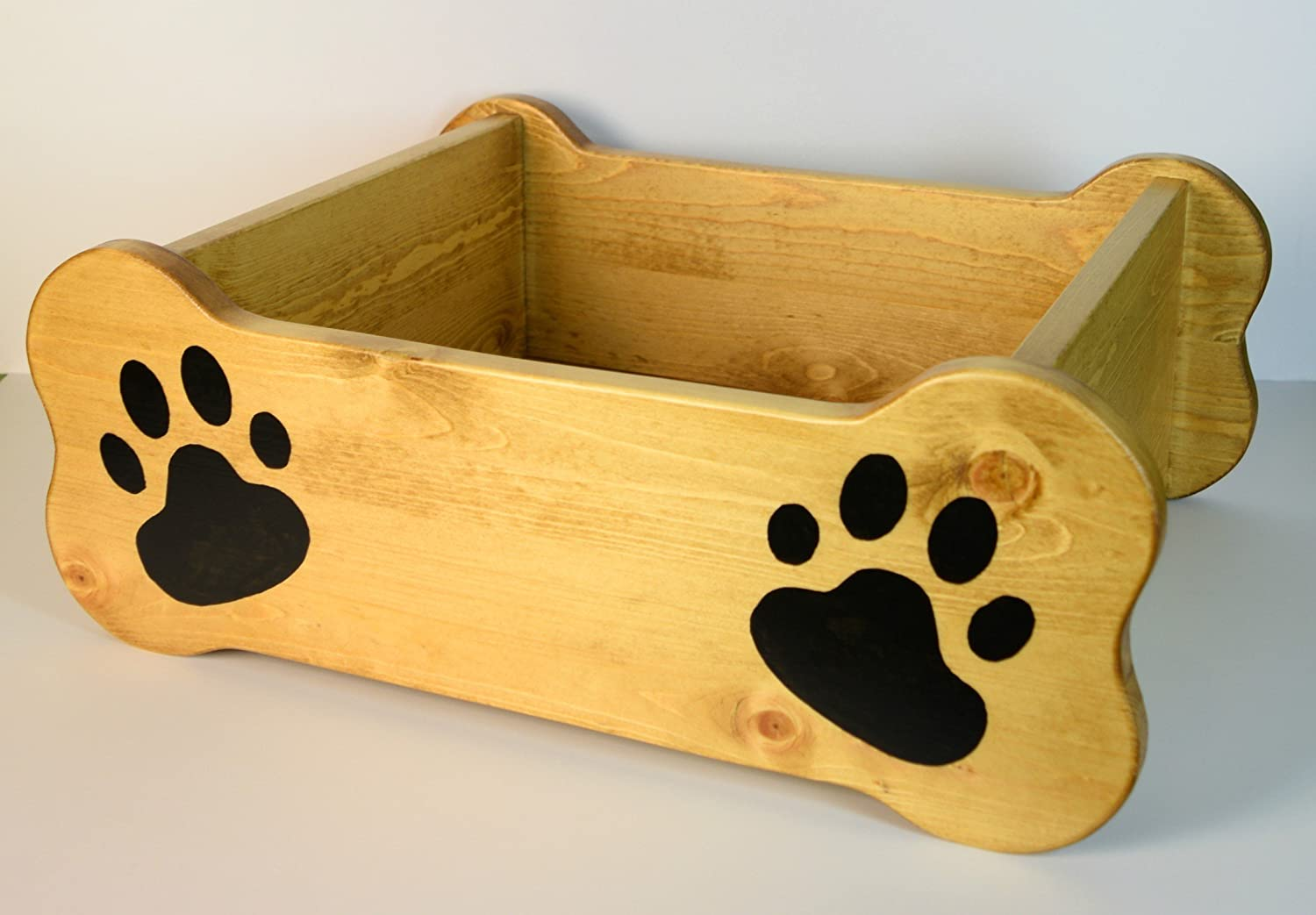 Dog toy box, pet storage bin, small dog bed, paw print paint, wood container, chew toy, rope, bone, fur baby critter, oak stain