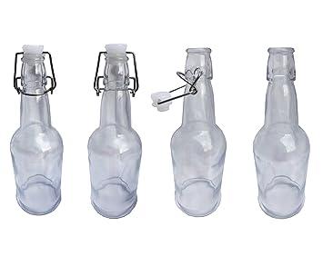 Paquete de botellas de vidrio transparente y estilo clásico ...