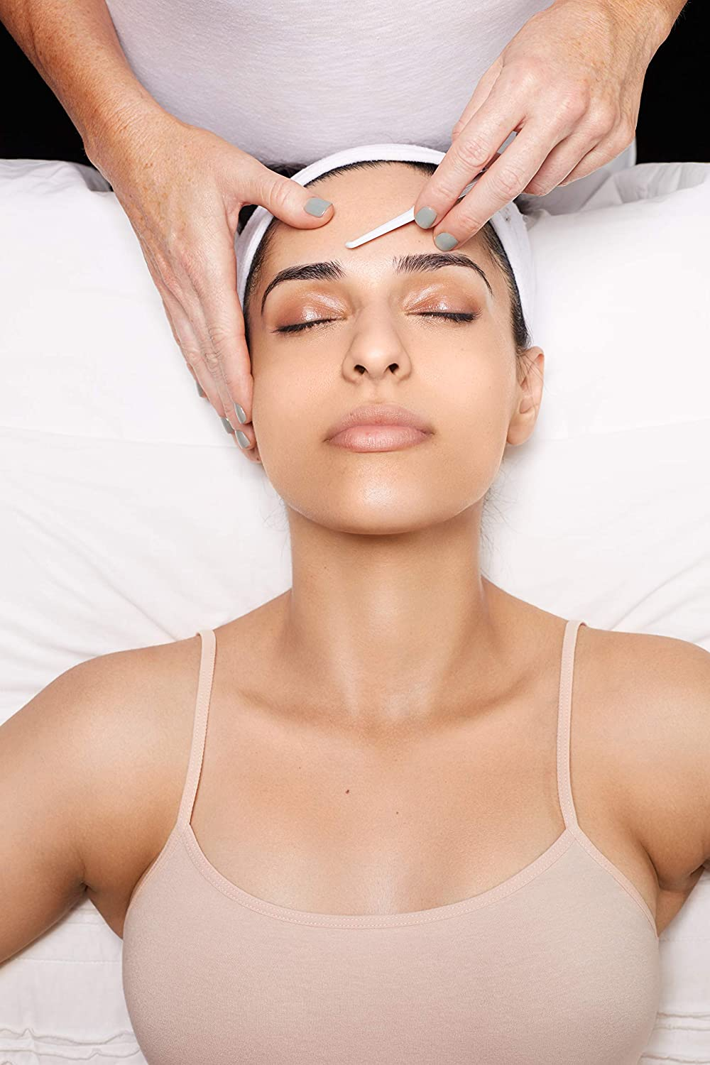 woman getting dermaplaning done