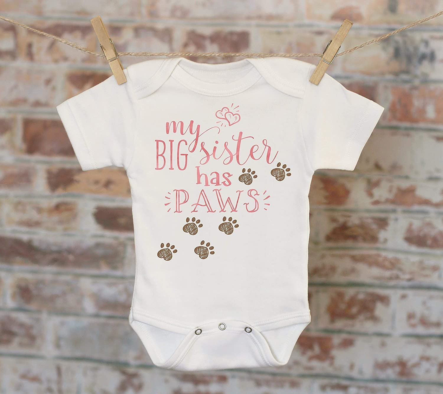 My big sister has Paws white baby grow bodysuit vest.