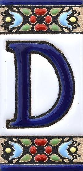 """Image ofLetreros con numeros y letras en azulejo de ceramica, pintados a mano en técnica cuerda seca para nombres y direcciones. Texto personalizable. Diseño FLORES MINI 7,3 cm x 3,5 cm. (LETRA """"D"""")"""
