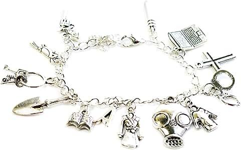 Pulsera inspirada en «Pretty Little Liars», tono plateado, con abalorios de ordenador portátil, abrigo, cruz, libro, pala y más, de Beaux Bijoux: Amazon.es: Joyería