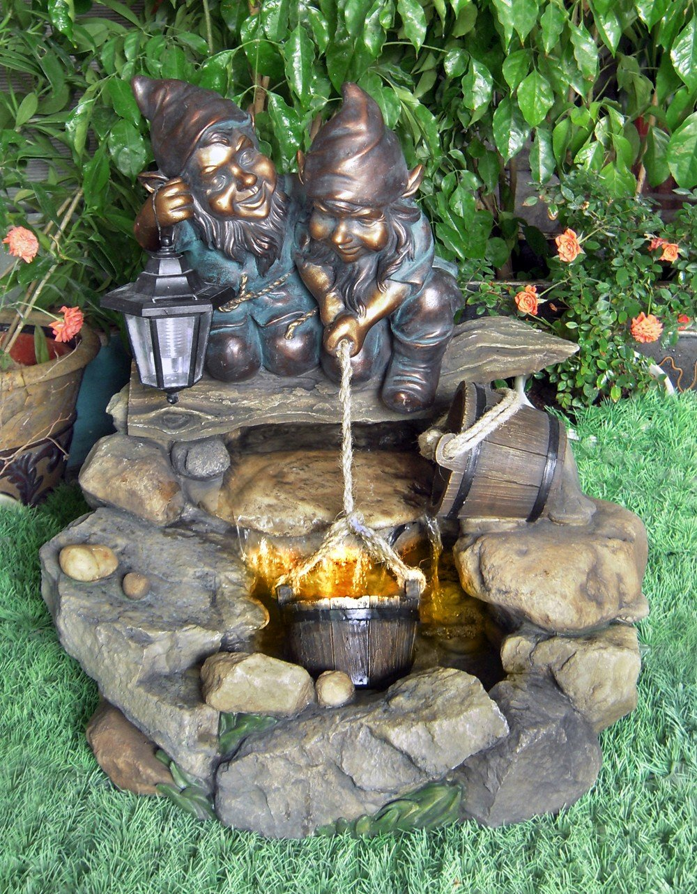 Two Gnomes At Rock Pool Water Feature With Lights