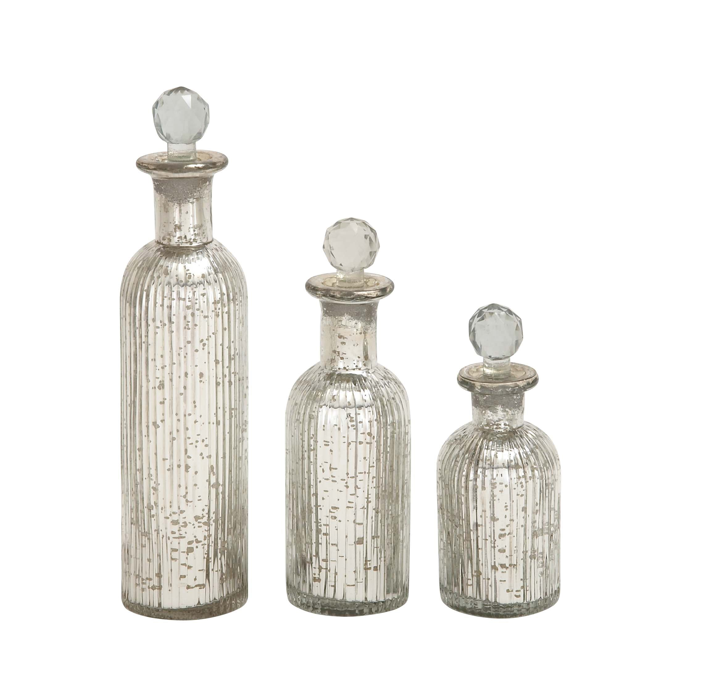 Deco 79 Classic Clear Glass Bottles with Decorative Stoppers, Set of Three - 7 inch, 9 inch, and 12 inch