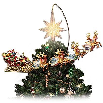 thomas kinkade holidays in motion rotating illuminated treetopper animated christmas decor by the bradford editions