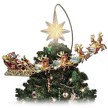 Thomas Kinkade Holidays in Motion Rotating Illuminated Treetopper: Animated  Christmas Decor by The Bradford Editions - Amazon.com: Thomas Kinkade Holidays In Motion Rotating Illuminated