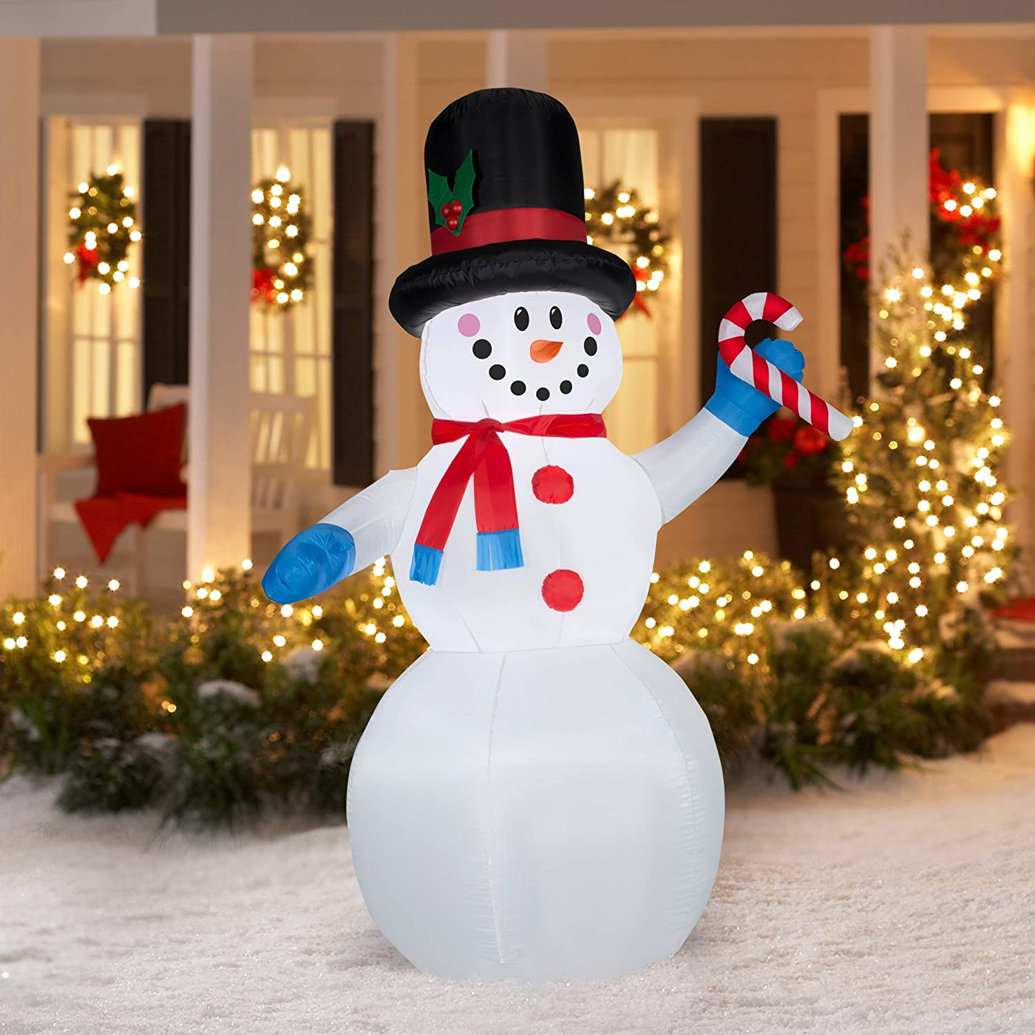 Amazon.com: 7 Foot Festive Snowman with Candy Cane Airblown ...