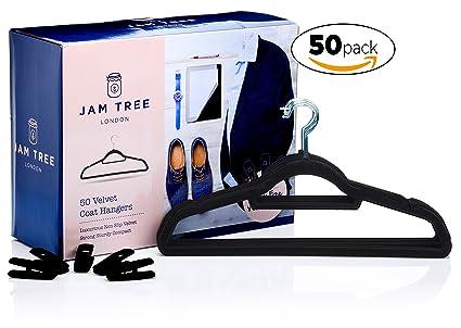 50 perchas de terciopelo con pinzas para faldas y pantalones. Estas perchas cuentan con suspensiones