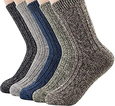 Mottled wool socks in a variety of shades on a white background