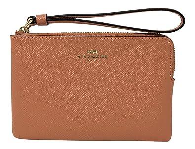 9fa0bffa1734b Coach Crossgrain Leather Corner Zip Small Wristlet Sunrise F58032  Handbags   Amazon.com
