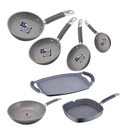 Bateria de cocina profesional: sartenes profesionales, wok y parrillas.