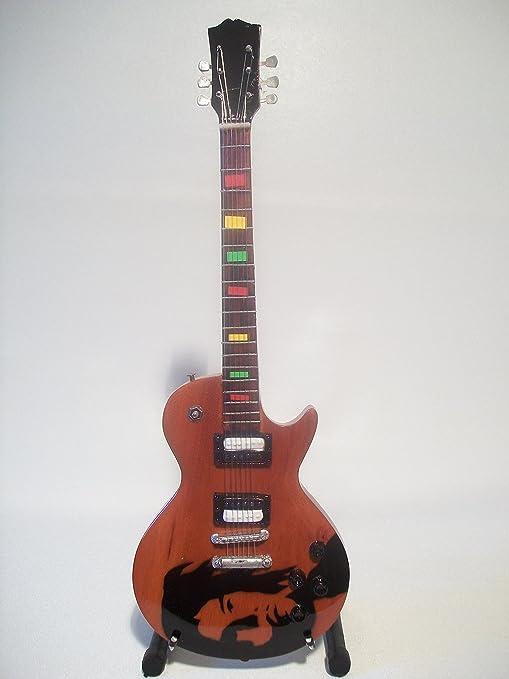 Mini guitarra de colección - Replica mini guitar - Bob Marley - Tribute: Amazon.es: Instrumentos musicales