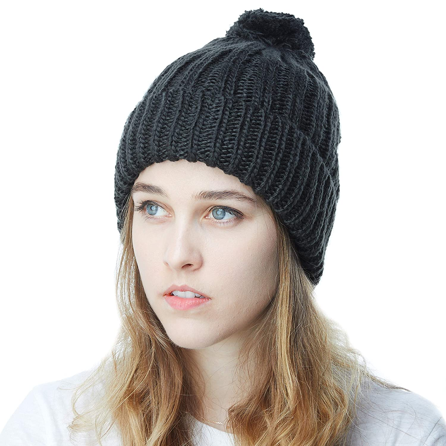 73e86891218b2 THE HAT DEPOT Winter Unisex Soft Warm Beanie Sherpa Lined Pom Pom Beanie  Skully Hat (Black) at Amazon Women s Clothing store