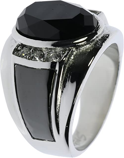 Black and goldtone w cross design. Stainless steel two toned ring