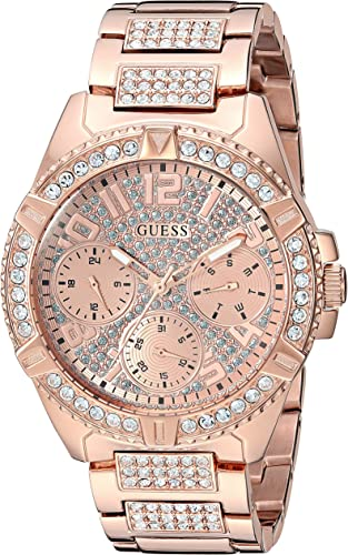 GUESS Rose Gold Tone Stainless Steel Crystal Watch with Day, Date + 24 Hour MilitaryInt'l Time. Color: Rose Gold Tone (Model: U1156L3)