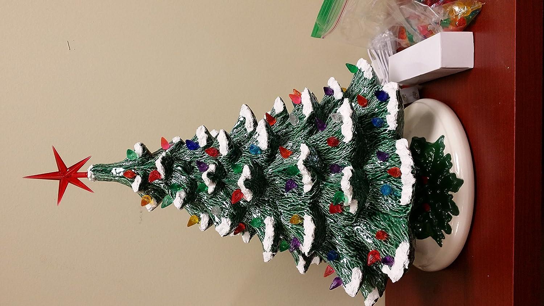 Amazoncom Ceramic Christmas Tree 18 green with snow Home  Kitchen
