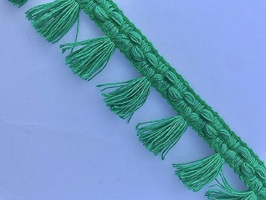 Cinta de borla de color verde esmeralda con un bonito disfraz de ...