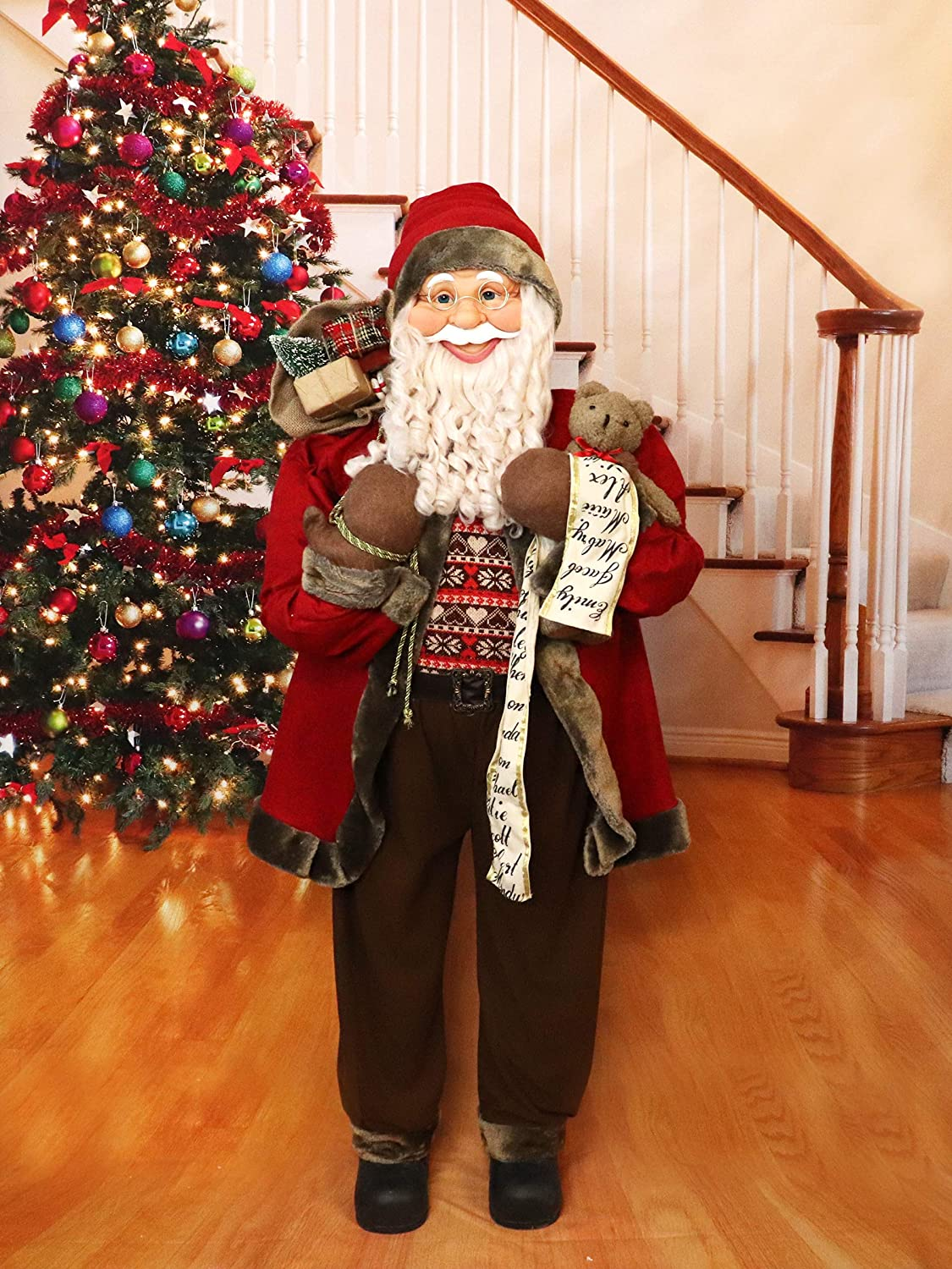 Fraser Hill Farm Life-Size Indoor Christmas Decoration, 5-Ft. Standing Santa Claus with Scroll, Gift Sack, and Bear, Wearing a Nordic Sweater, Red
