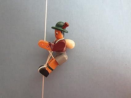 Enanos-escalada en la figura de alpinista chaqueta marrón ...