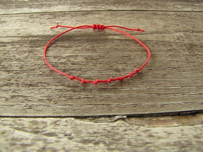 5696750025e412 bracelet Porte bonheur kabbale - fil rouge 7 noeuds  Amazon.fr  Handmade
