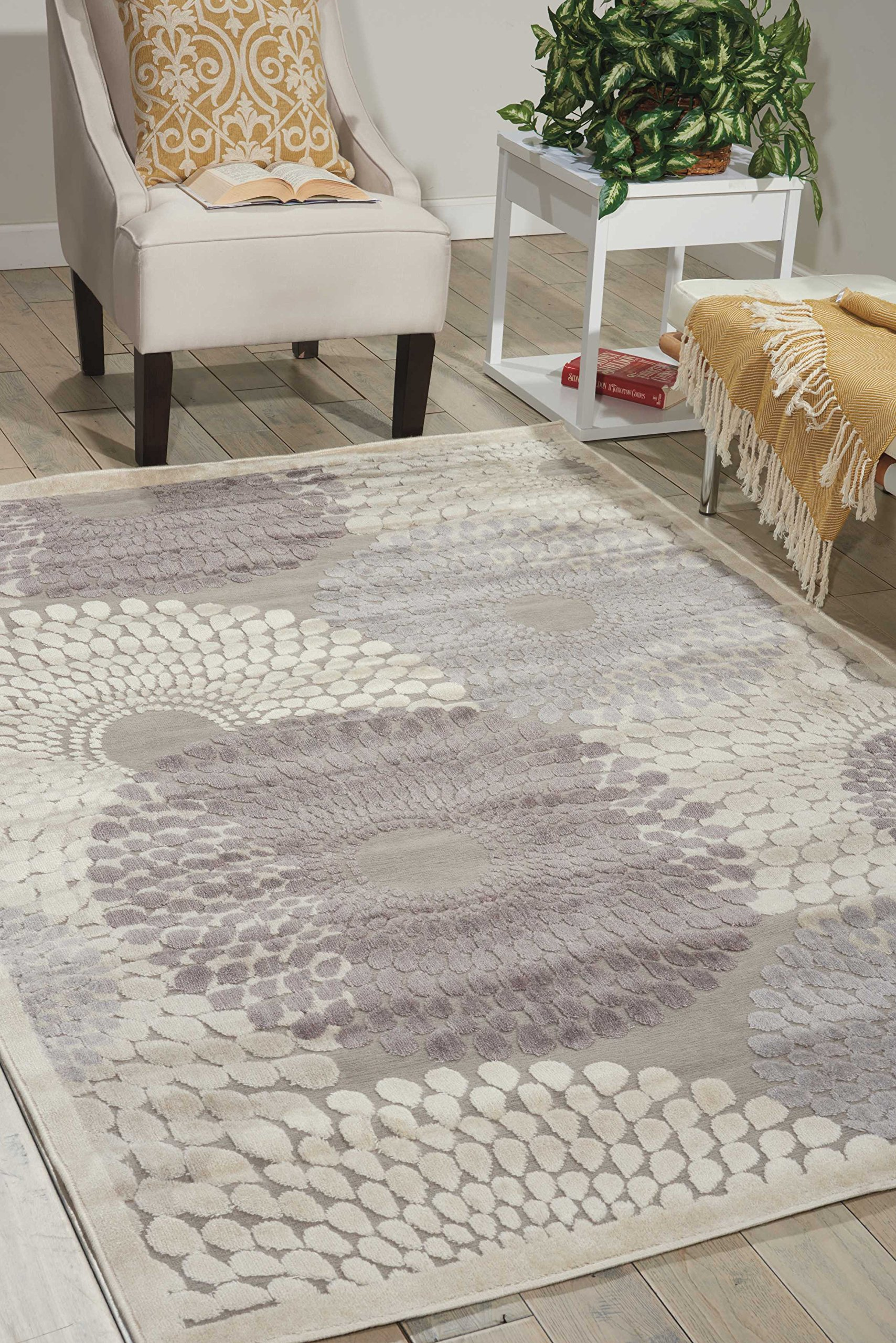 """Nourison Graphic Illusions (GIL04) Grey Rectangle Area Rug, 5-Feet 3-Inches by 7-Feet 5-Inches (5'3"""" x 7'5"""") - Graphic Illusions Grey 5'3"""" x 7'5"""" area rug by Nourison, part of the Graphic Illusion Collection, is another quality home décor essential for your high-traffic living spaces. Nobody does floor coverings like Nourison and the Graphic Illusions Grey 5'3"""" x 7'5"""" area rug is part of a best-seller collection from this world-renowned rug powerhouse. Nourison is the leader in elegant floor covering construction with a wide selection of rugs and world-class product quality. This commitment to maintaining an outstanding reputation is a special point of pride throughout the company. In this best-seller collection, Nourison's proprietary high-low pile construction gives this Grey 5'3"""" x 7'5"""" indoor rug an elegant look and feel that is unparalleled in the rug industry. Hand-woven with 30% polypropylene and 70% acrylic, this unique blend ensures a soft touch and easy maintenance; it is naturally water-, stain- and soil-resistant with no topical treatments applied. Just vacuum and spot clean for great results. Use this rug for your bedroom or living room. - living-room-soft-furnishings, living-room, area-rugs - 910eNQ6%2B4CL -"""