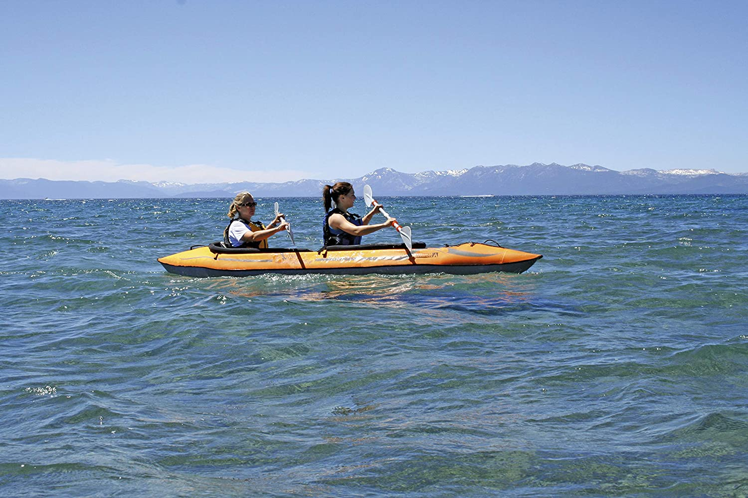 two woman paddling in a kayak on an ocean