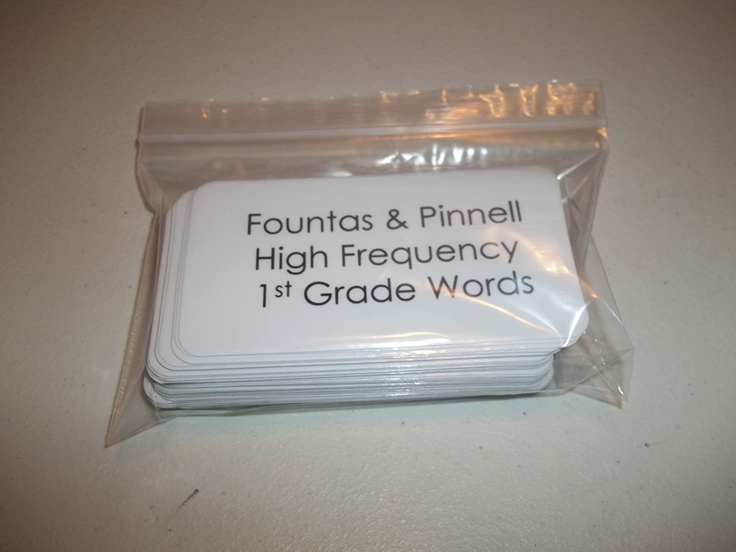 57 laminated Fountas and Pinnell based First Grade high frequency flashcards set.