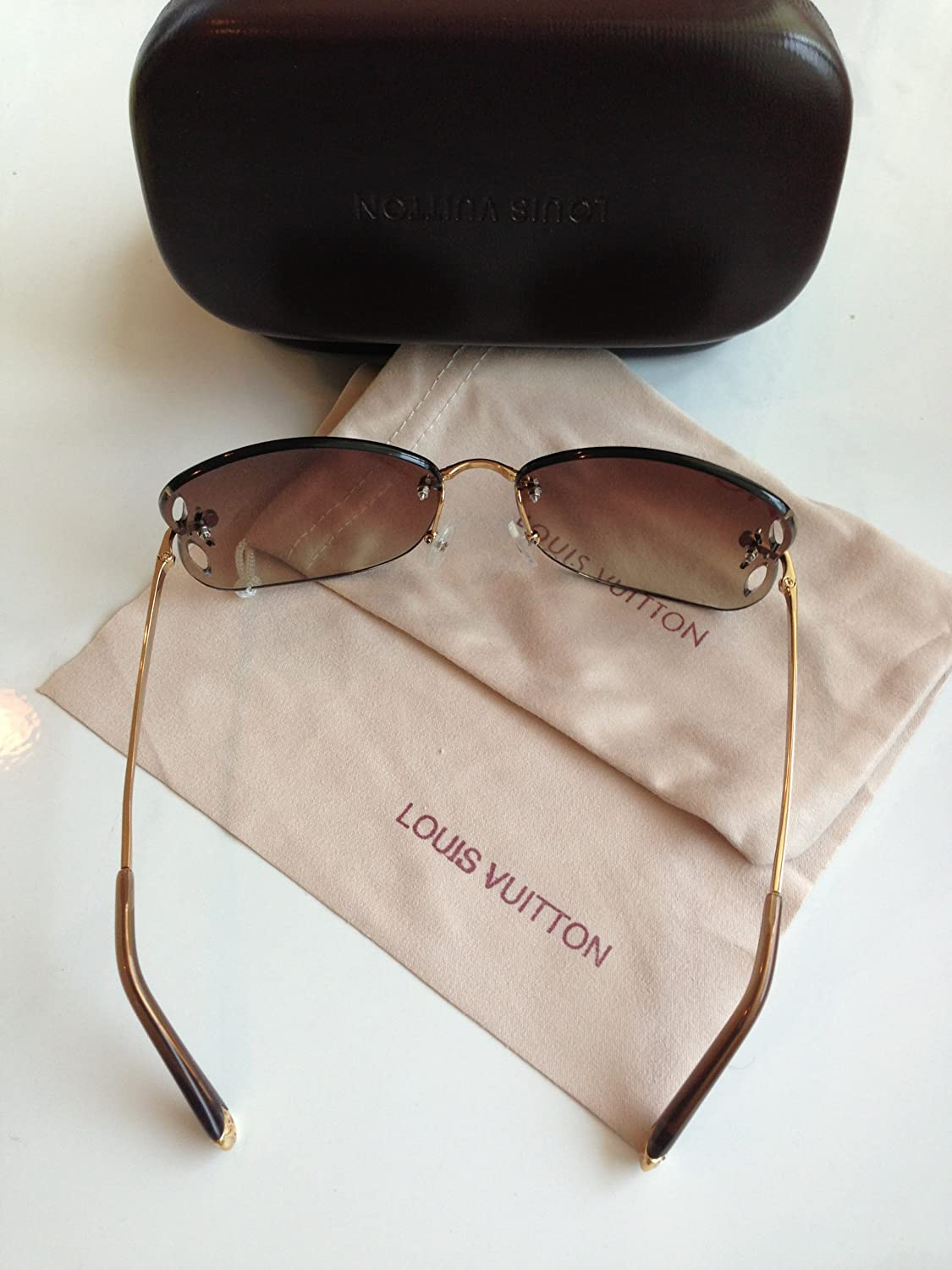 14753197ad Authentic Louis Vuitton LILY STRASS Sunglasses  Amazon.co.uk  Clothing
