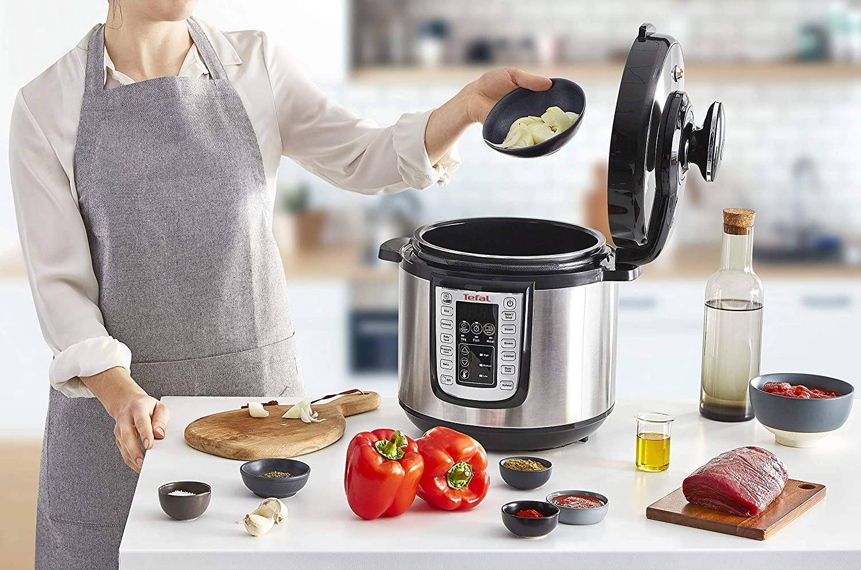 Tefal cy505e40 Todo-en-uno cy505e40 eléctrico presión/Multi Cocina, (6 porciones), Negro/Acero Inoxidable: Amazon.es