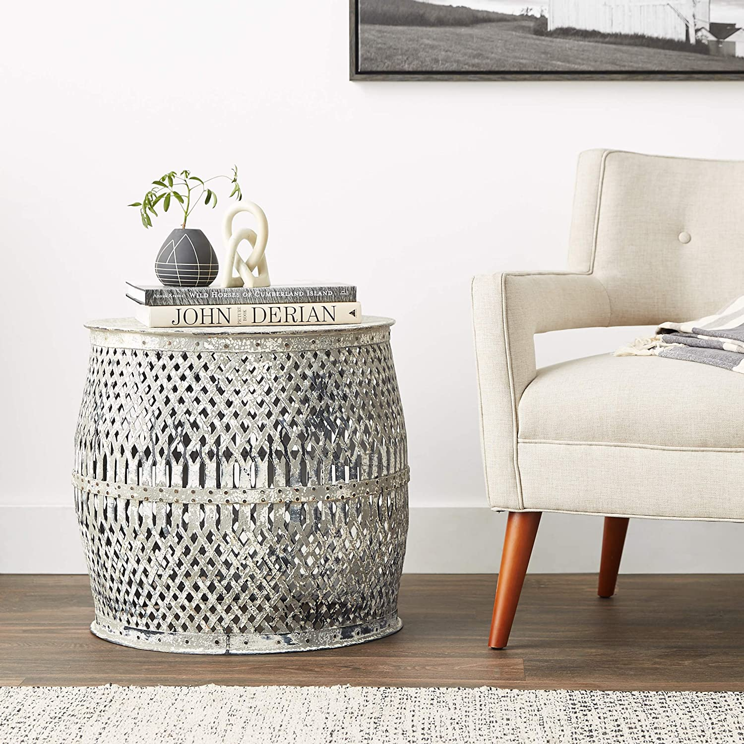 Distressed white metal drum table for French farmhouse decorating and European country interior design.