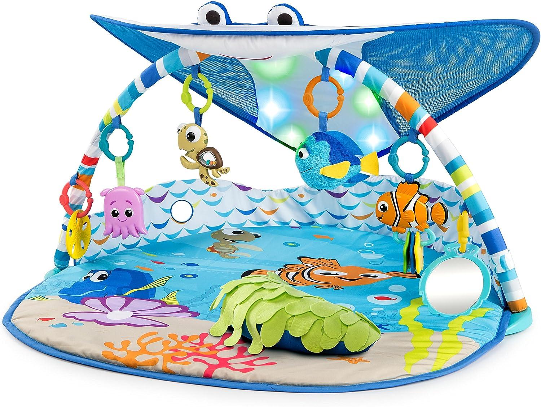 bright starts disney baby tapis d eveil le monde de nemo mr ray ocean lights lumieres et plus de 20 minutes de melodies marionnette a doigts dory