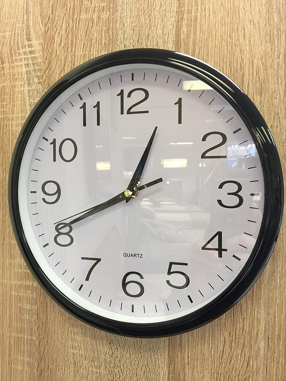 """Black Quartz """"No tick"""" silent Wall Clock- perfect as a kitchen clock or office clock or home clock. High quality Quartz movement for improved accuracy and durability. """"No tick"""" movement is ideal for those wishing a silent clock. High quality black bezel l"""