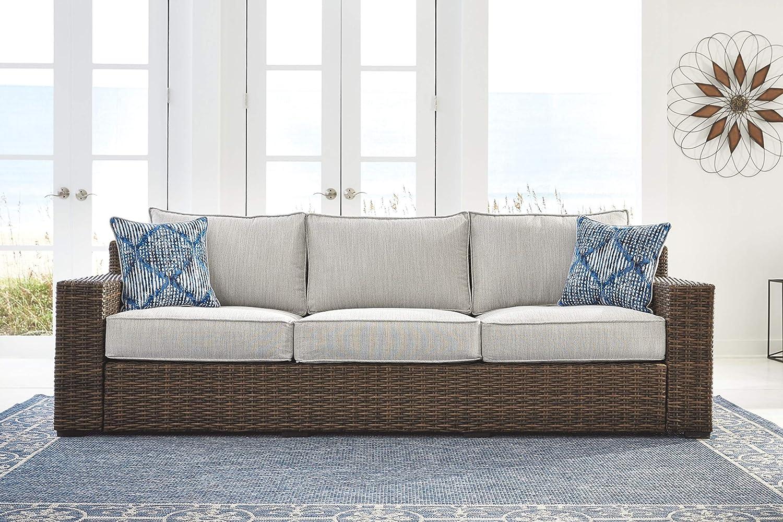 Ashley Furniture Signature Design - Alta Grande Outdoor Sofa with Cushion - Beige & Brown