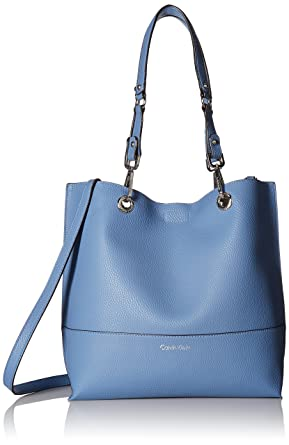 bb90f8326 Amazon.com: Calvin Klein womens Calvin Klein Sonoma Faux Leather Reversible  North/South Tote, peri/silver, One Size: Clothing