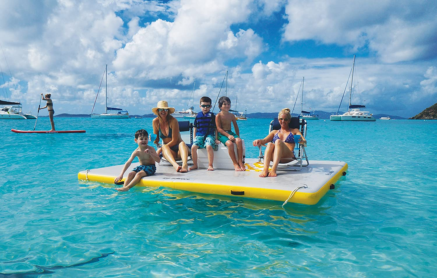 a family lounging on an inflatable platform