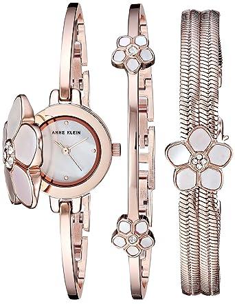 640f0bd4ffc Amazon.com  Anne Klein Women s Swarovski Crystal Flower Accented Rose Gold-Tone  Bangle Watch and Bracelet Set  Watches