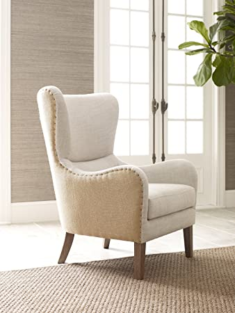 elle decor midcentury modern wingback chair in french twotoned beige