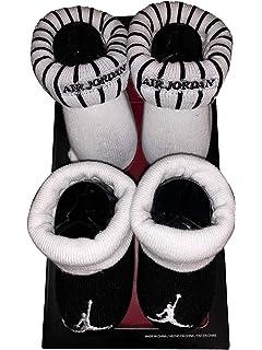 09e63a66588 Amazon.com  Nike Air Jordan Elephant Print Hat   Booties Set 0-6 ...