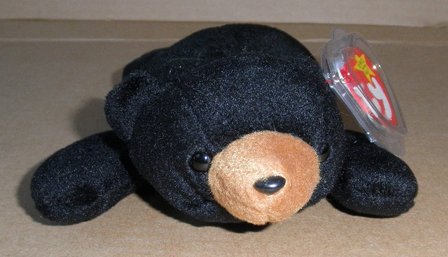 Amazon.com  TY Beanie Babies Blackie Bear Stuffed Animal Plush Toy - 9 inches  long - Black with Brown Nose  Office Products 7f775e189b77
