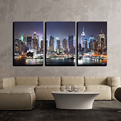 Wall26 3 Piece Canvas Wall Art   New York City Manhattan Skyline Panorama  At Night