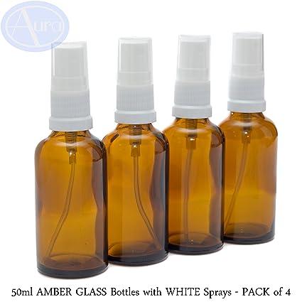 Paquete de 4 frascos de cristal ámbar de 50 ml con atomizador blanco