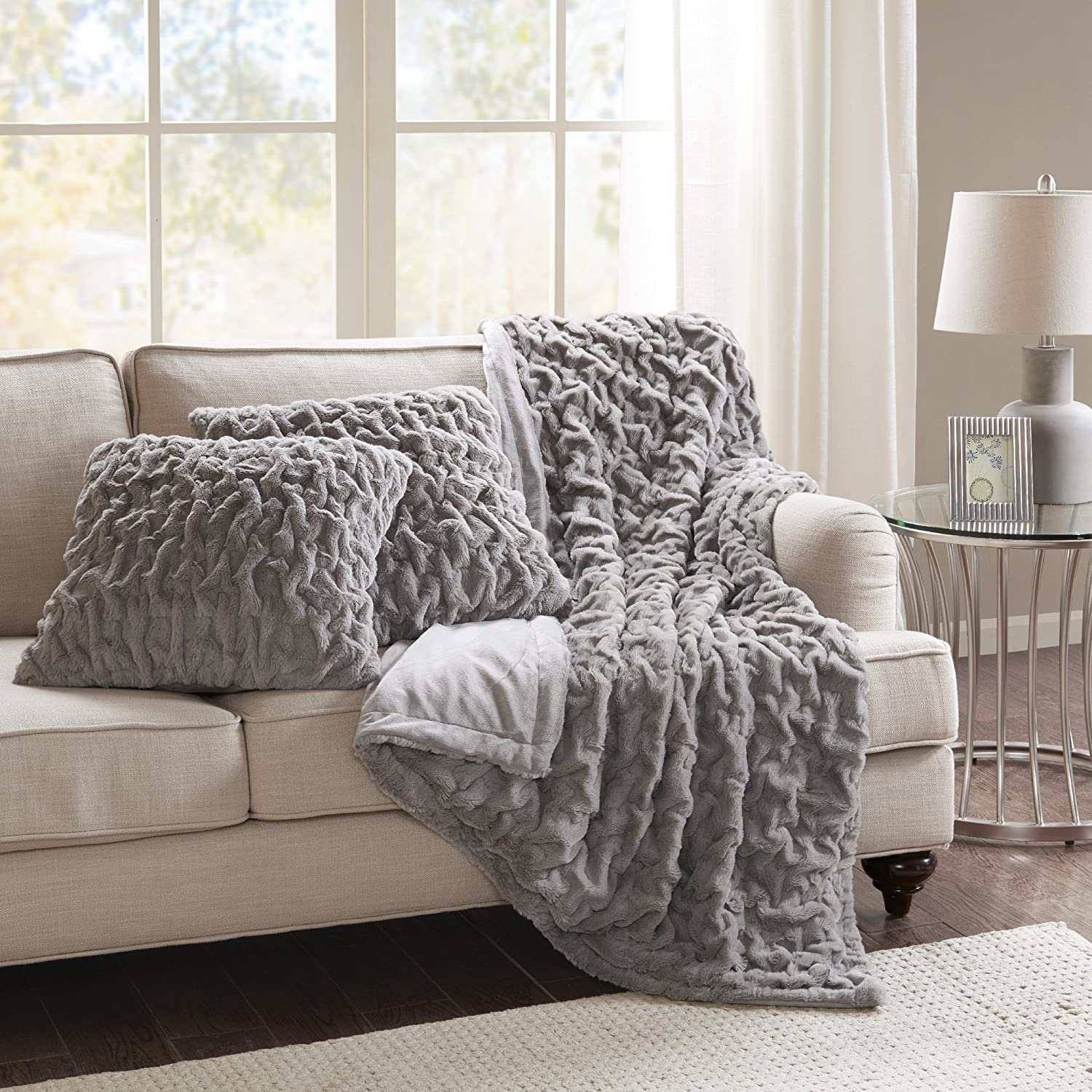 Neutral living room accessories throw pillows blanket cozy style