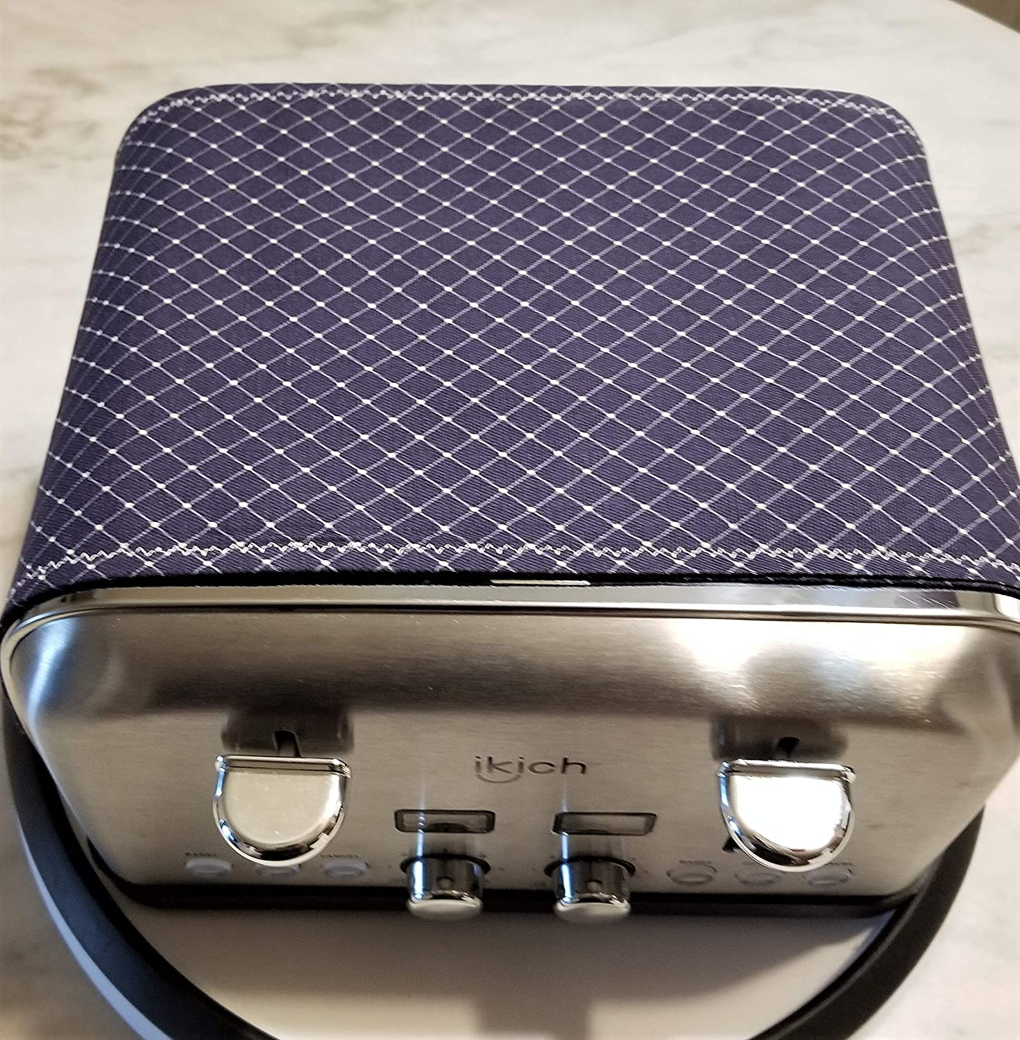 Toaster Huggee/® Toaster Cover will help keep dust /& other airborne particles from floating into your open toaster slots!