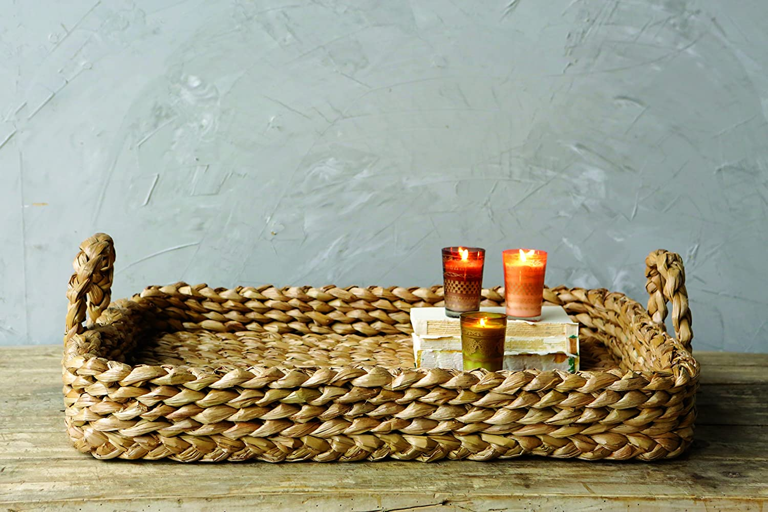 Woven rustic basket tray with handles for coastal, French country, boho, and rustic farmhouse style spaces and decorating.