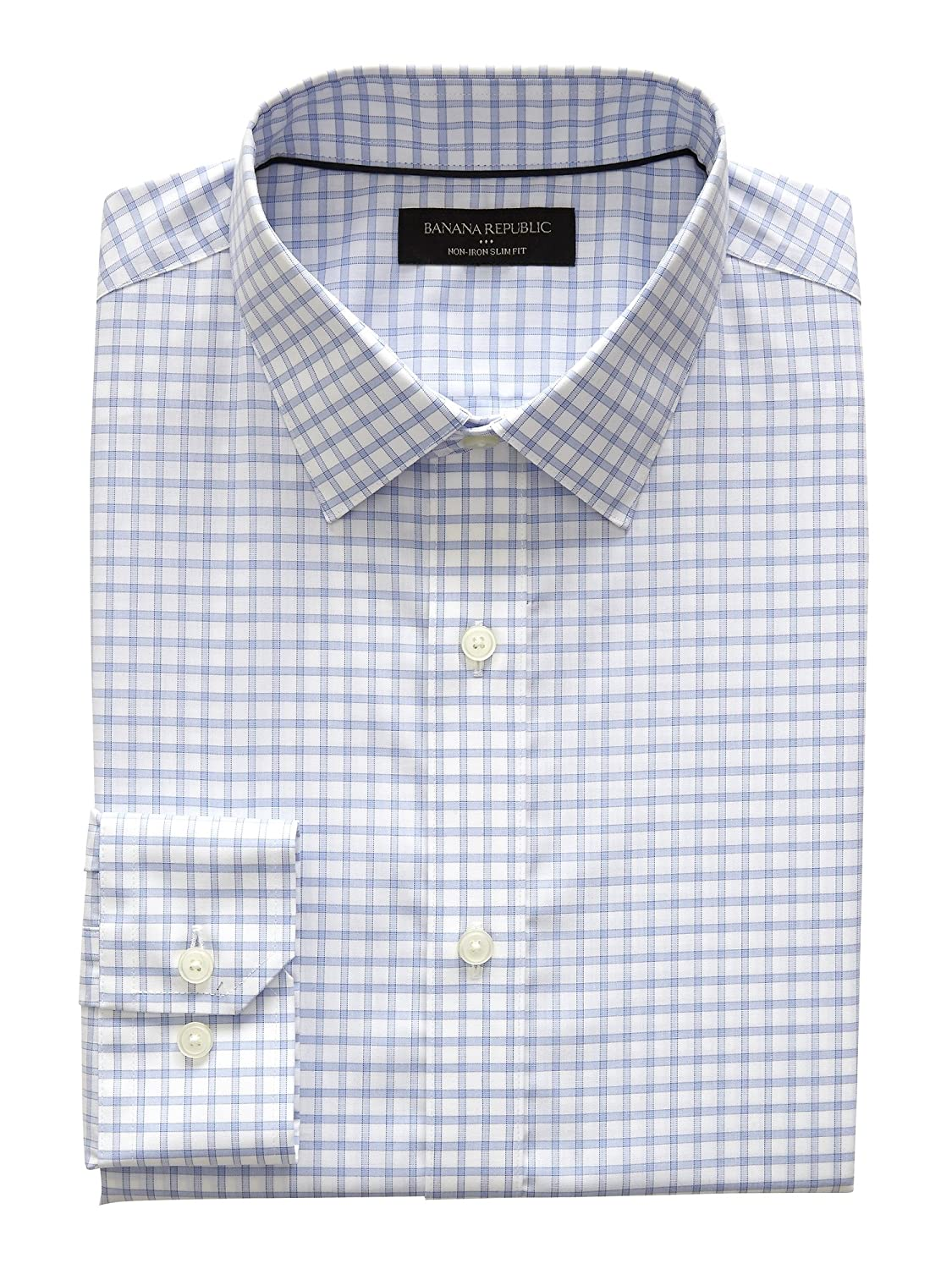 a903ab2c5c Slim Fit  Slim cut in the chest and sleeves. Tapered through the waist.  Spread collar. Clean front. Innovative non-iron technology makes this shirt  ...