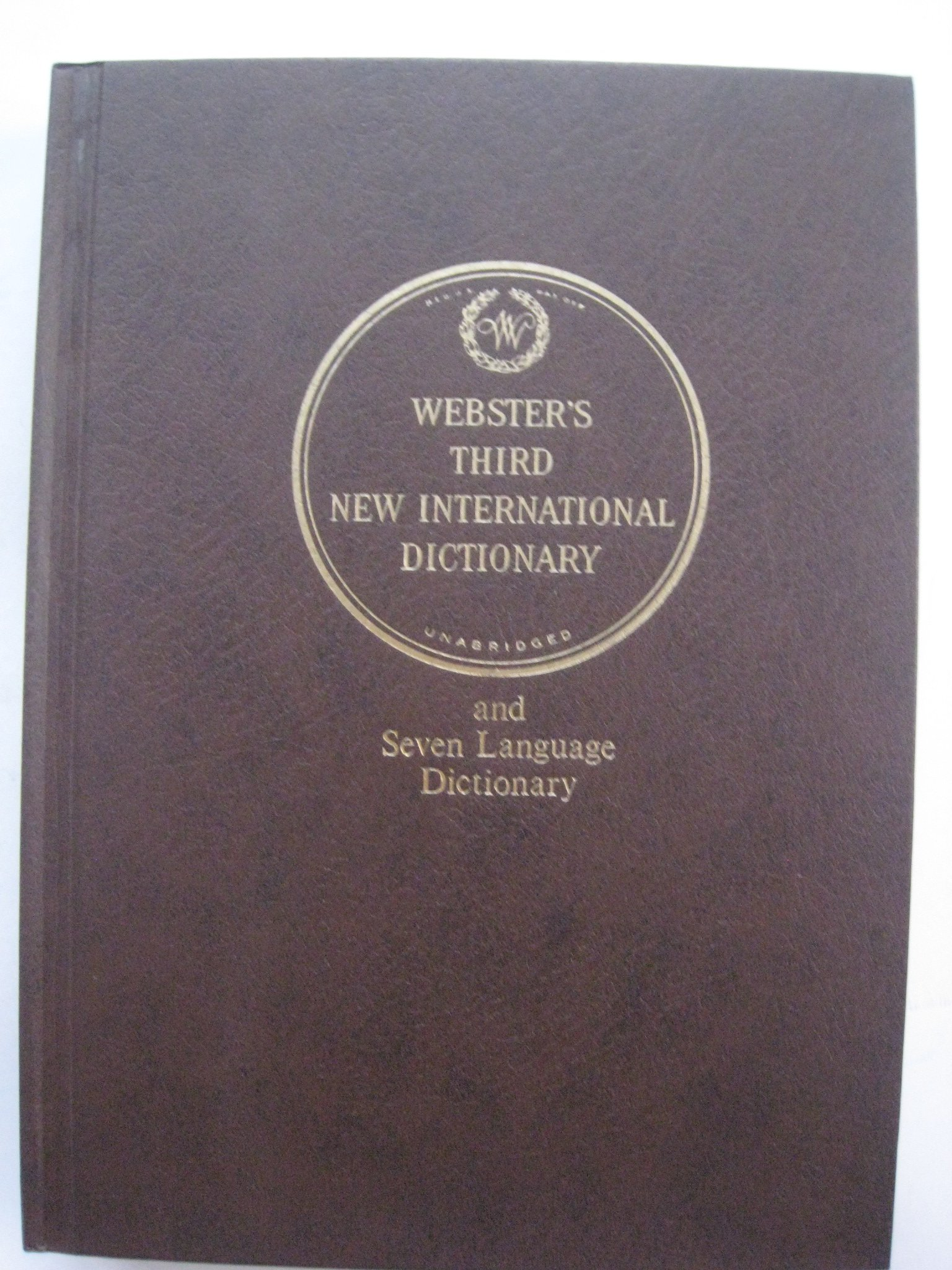 Webster's Third New International Dictionary and Seven Language Dictionary (Unabridged  in Three Volumes) Hardcover – 1986
