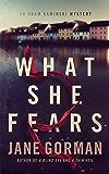 What She Fears: Book 4 in the Adam Kaminski Mystery Series