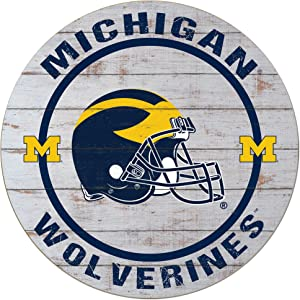"""KH Sports Fan 20""""x20"""" Weathered Michigan Wolverines Helmet Circle Wall Sign"""