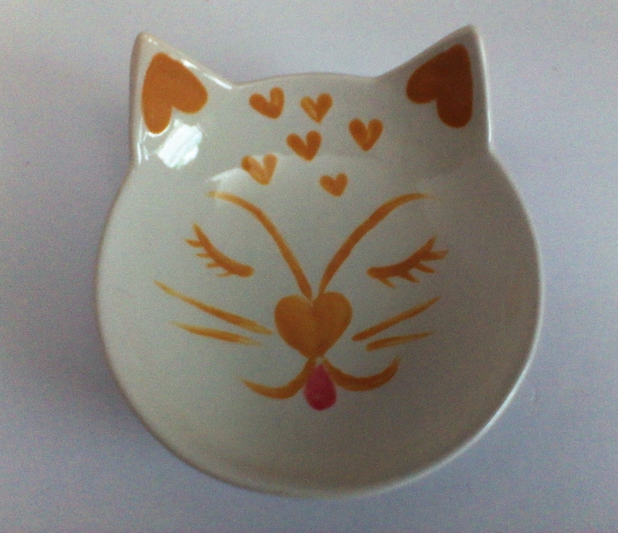 A happy cat water or feeding bowl in brown and white