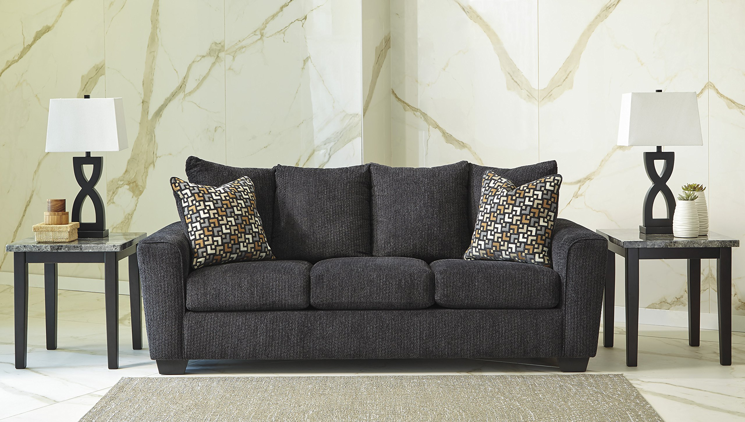 Wixon Dark Gray Fabric Pillow Back Sofa - This trendy sofa features cushion cores that are constructed of low melt fiber wrapped over high quality foam to add incredible comfort to your relaxation experience. The large profile provides you with ample seating space, and sharpe arms give it a modern look. Corners are glued, blocked and stapled. Seats and back spring rails are cut from hardwood and engineered lumber. The black finish provides welcome contrast with the slate color chenille upholstery, while thick pillow back and matching throw pillows finish off the look. - sofas-couches, living-room-furniture, living-room - 916pYpTyyiL -